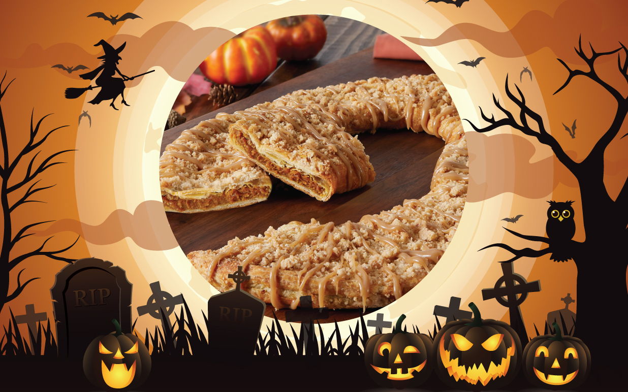 Pumpkin Kringle surrounded by halloween witches, bats and pumpkins.